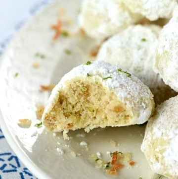 Lime Coconut Snowballs ~ tender shortbread-like cookies studded with lime zest & toasted coconut and generously rolled in powdered sugar for perfect year-round treats...from the lazy days of summer to a Christmas cookie platter!   FiveHeartHome.com