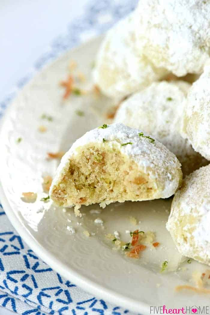 Close-up of Lime Coconut Snowball Cookies with missing bite