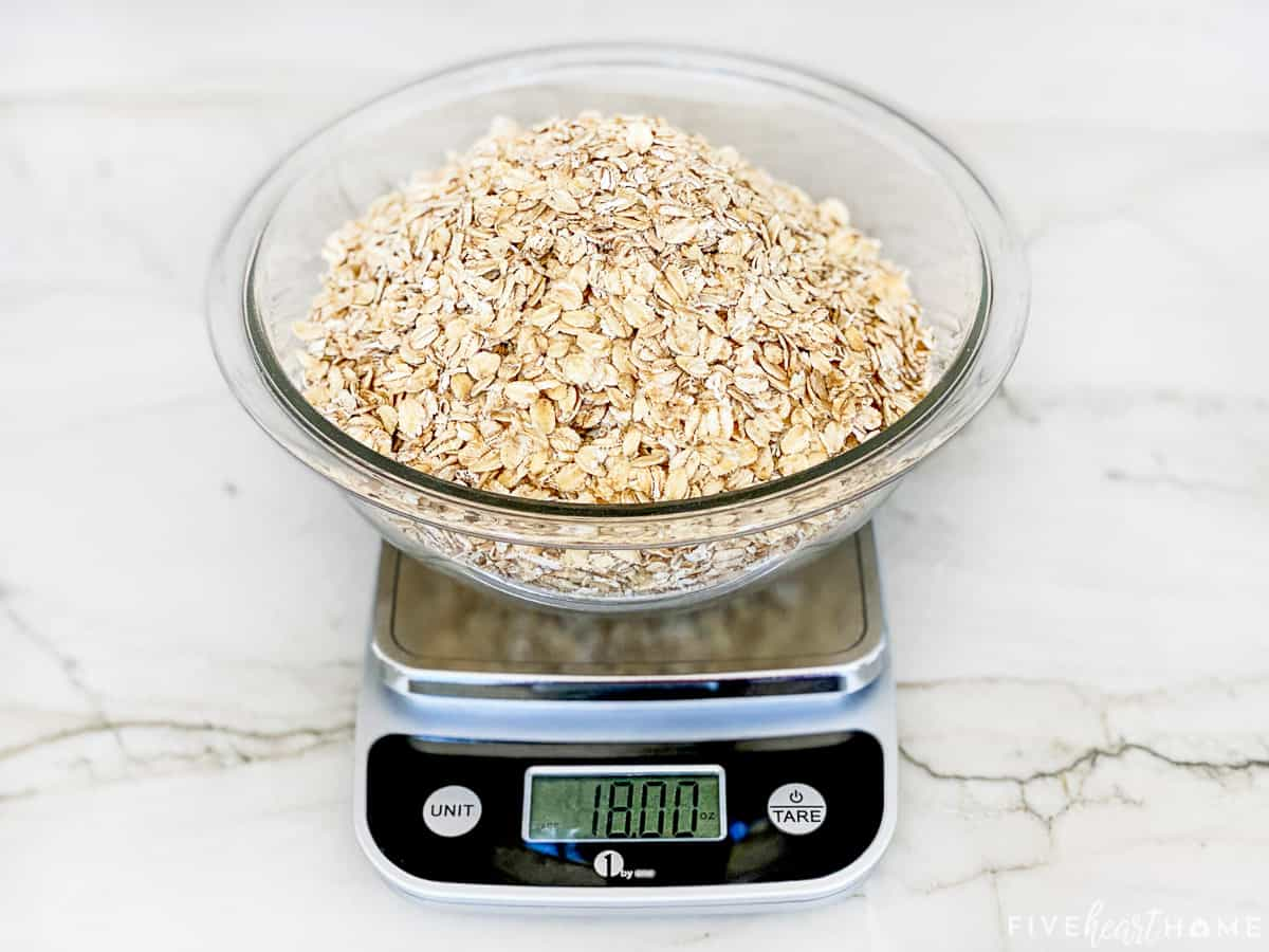 18 ounces of rolled oats measured on a kitchen scale.