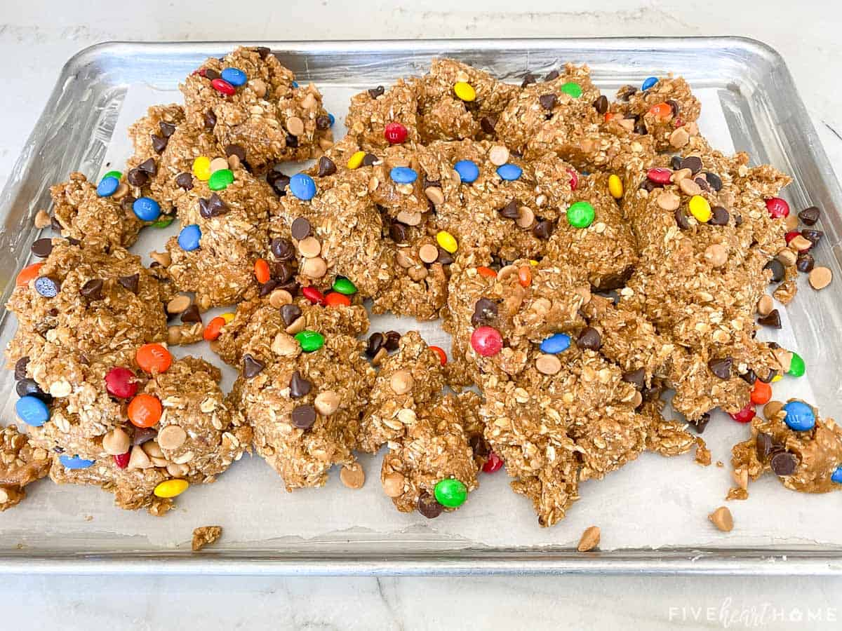 Monster Cookie Bars dough in sheet pan.