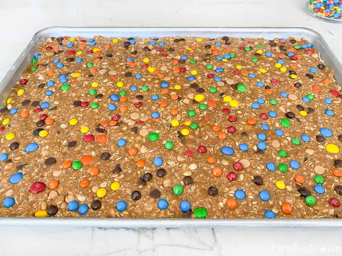 Monster Cookies dough pressed into sheet pan.