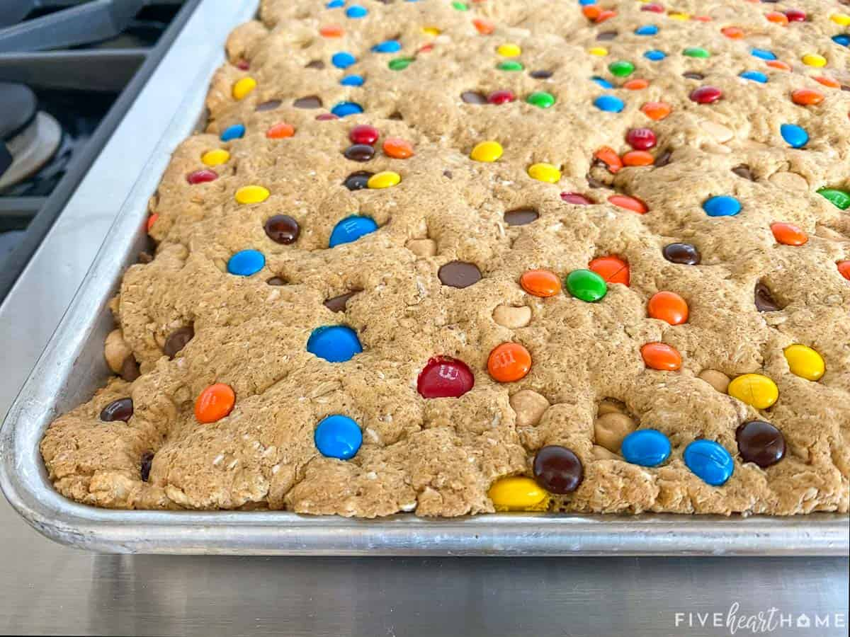 Close-up of baked Monster Cookie Bars in pan.
