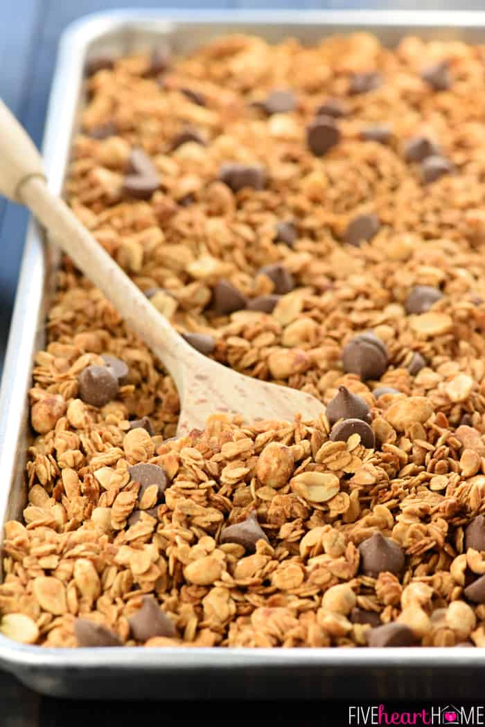 5-Ingredient Peanut Butter Granola on Baking Sheet with Wooden Spoon