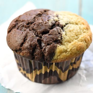 Banana Bread and Chocolate Muffin on turquoise tabletop
