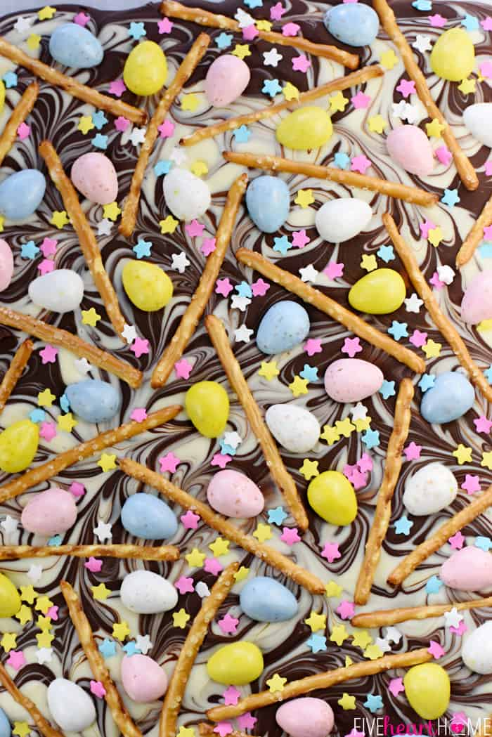 Aerial shot of Easter Bark with swirled chocolate, mini chocolate eggs, pretzels, and sprinkles