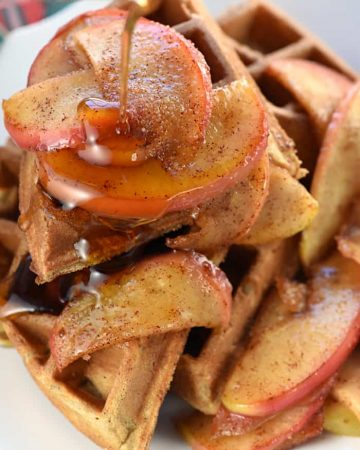 Apple Cinnamon Waffles with syrup being poured on top.