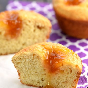 Peachy Cornbread Muffins ~ tender, lightly sweetened, and filled with a dollop of peach preserves for a delicious breakfast, brunch, or snack! | FiveHeartHome.com