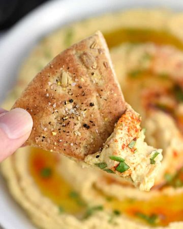 Roasted Garlic Hummus ~ mellow roasted garlic is blended with chickpeas, tahini, olive oil, and lemon juice for a fresh, creamy hummus that's delicious with homemade pita chips or crunchy veggie dippers! | FiveHeartHome.com