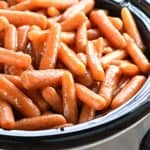 Slow Cooker Honey Cinnamon Carrots ~ a sweet, buttery, and addictive side dish...the perfect recipe for freeing up the oven and feeding a crowd, on Easter, any holiday, or a regular weeknight! | FiveHeartHome.com