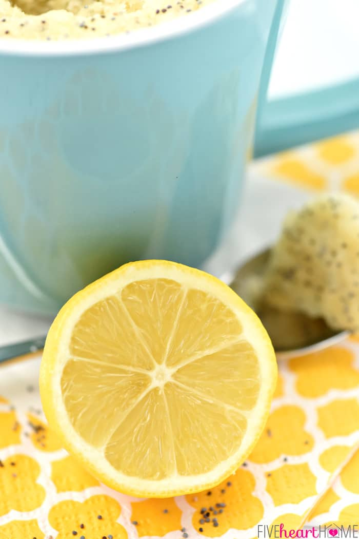 Lemon half leaning on turquoise mug