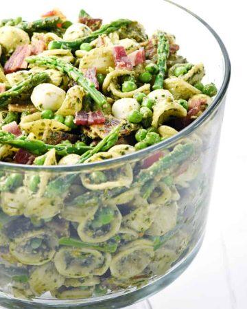 Pesto Pasta Salad in glass bowl.