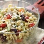 Greek Chicken Pasta Salad ~ marinated chicken, juicy tomatoes, crunchy cucumbers, artichoke hearts, Kalamata olives, and feta cheese are tossed with corkscrew pasta and a tangy dressing in this colorful, flavorful recipe that's perfect for summer barbecues and get-togethers! | FiveHeartHome.com