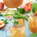 Minty Peach Tea Punch in glasses and pitcher with mint garnish.