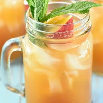 Minty Peach Tea Punch ~ a festive sparkling beverage of mint-infused tea mixed with fresh peach nectar, simple syrup, ginger ale, and club soda, perfect for spring or summer showers, barbecues, and parties! | FiveHeartHome.com