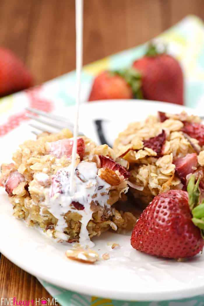 Strawberry Baked Oatmeal Cups ~ loaded with chewy oats, crunchy almonds, sweet coconut, and fresh diced strawberries, this wholesome, perfectly-portioned breakfast is ideal to make ahead of time and reheat in the morning! | FiveHeartHome.com