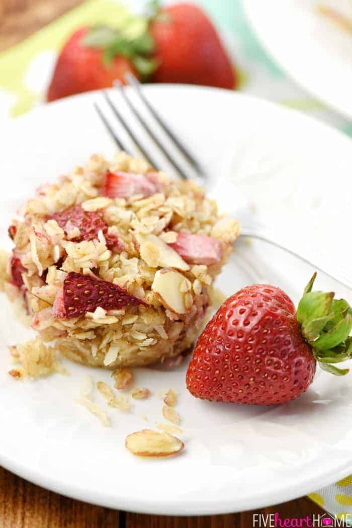 Strawberry Baked Oatmeal Cups on White Plate with Fork and Fresh Strawberries