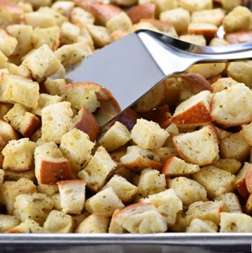Homemade Herbed Garlic Croutons ~ easy to make and a crunchy, flavorful way to jazz up your favorite salad and soup recipes, from Ceasar Salad to Tomato Soup...add Parmesan to make them even more special! | FiveHeartHome.com