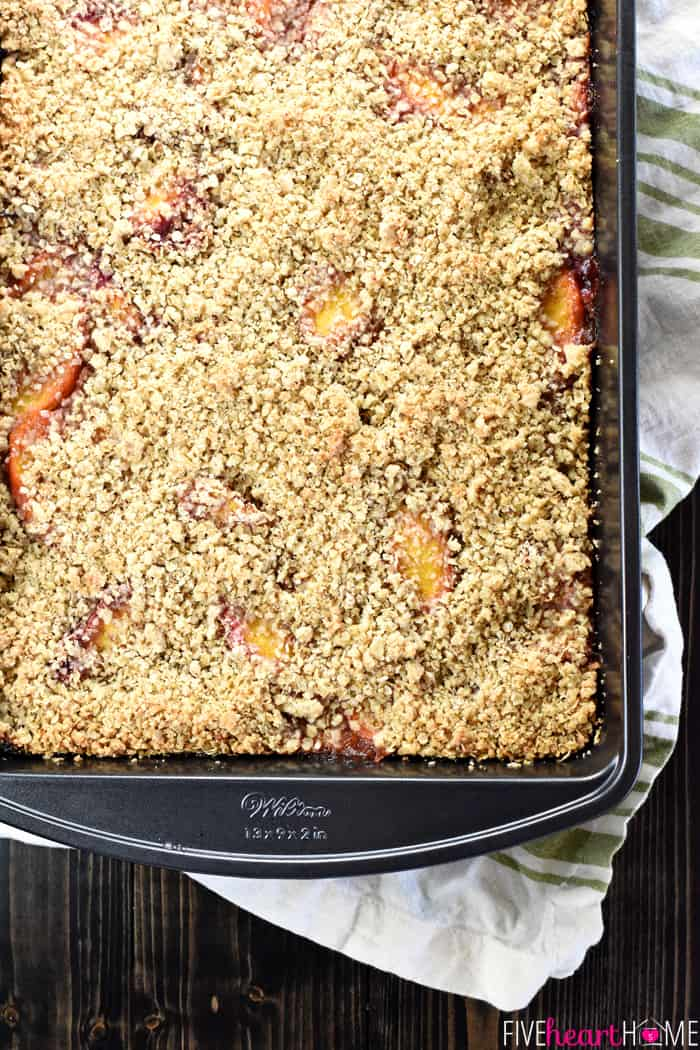 Peach Crisp Bars ~ a buttery shortbread crust is topped with sweet, ripe peaches and an oat-flecked crumble in this delicious, easy-to-assemble summertime dessert recipe! | FiveHeartHome.comcom