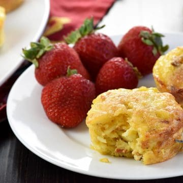 """Bacon, Potato, & Cheese Mini Frittatas ~ savory, fluffy """"egg muffins"""" loaded with crispy diced bacon, hash browns, and grated cheddar and baked in muffin pans for a filling and protein-packed breakfast or brunch!   FiveHeartHome.com"""