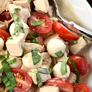 Caprese Chicken Salad ~ combines two summertime favorites, featuring juicy tomatoes, creamy mozzarella, and fresh basil tossed with diced chicken in a homemade, Greek yogurt-based balsamic dressing! | FiveHeartHome.com