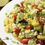 Corn Tomato Avocado Salad on white platter.
