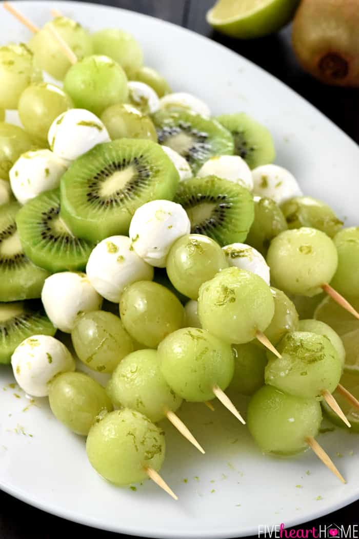 Fruit & Mozzarella Skewers with Honey Lime Drizzle ~ honeydew melon, green grapes, kiwi fruit, and fresh mozzarella balls are dressed up with a sweet and tangy syrup in these fun and healthy summer fruit kabobs that are delicious poolside, for picnics, or at any get-together! | FiveHeartHome.com