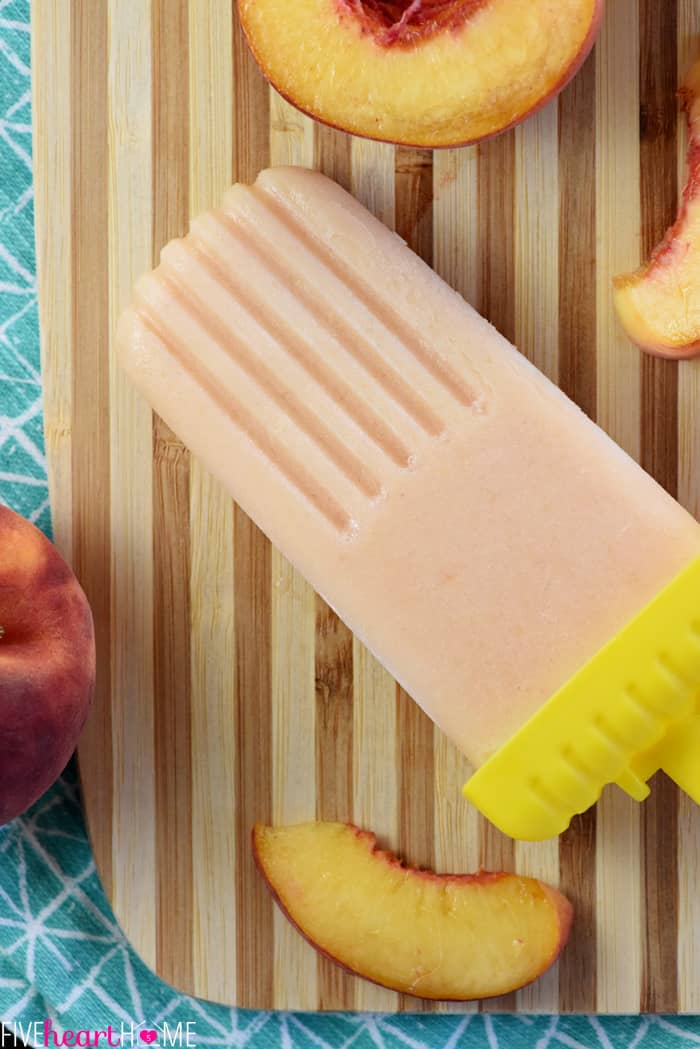 Peach Buttermilk Popsicles ~ with just four ingredients, these fruity, creamy, frozen treats are kissed with honey and balanced with a touch of buttermilk tang! | FiveHeartHome.com
