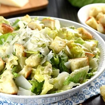 Classic Caesar Salad ~ with a flavorful (egg-free!) dressing, garlicky homemade croutons, and fresh shaved Parmesan atop crunchy hearts of romaine, this is the perfect side to just about any meal...or top with sliced chicken for a healthy, hearty entree! | FiveHeartHome.com