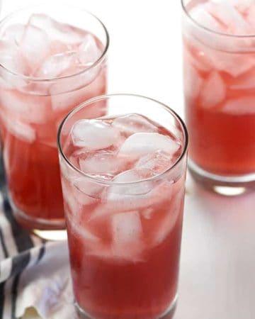 Three glasses of Homemade Gatorade with ice.