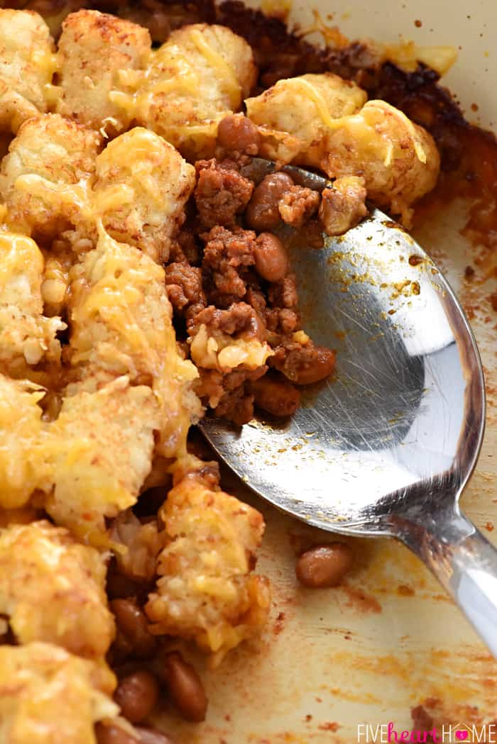 Sloppy Joe Tater Tot Casserole getting scooped up by serving spoon.