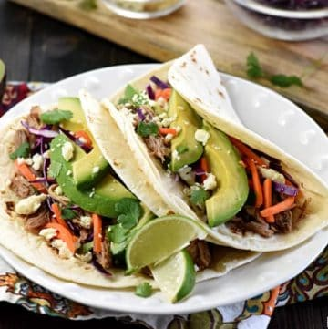 Slow Cooker Honey Lime Pulled Pork Tacos (or Nachos)