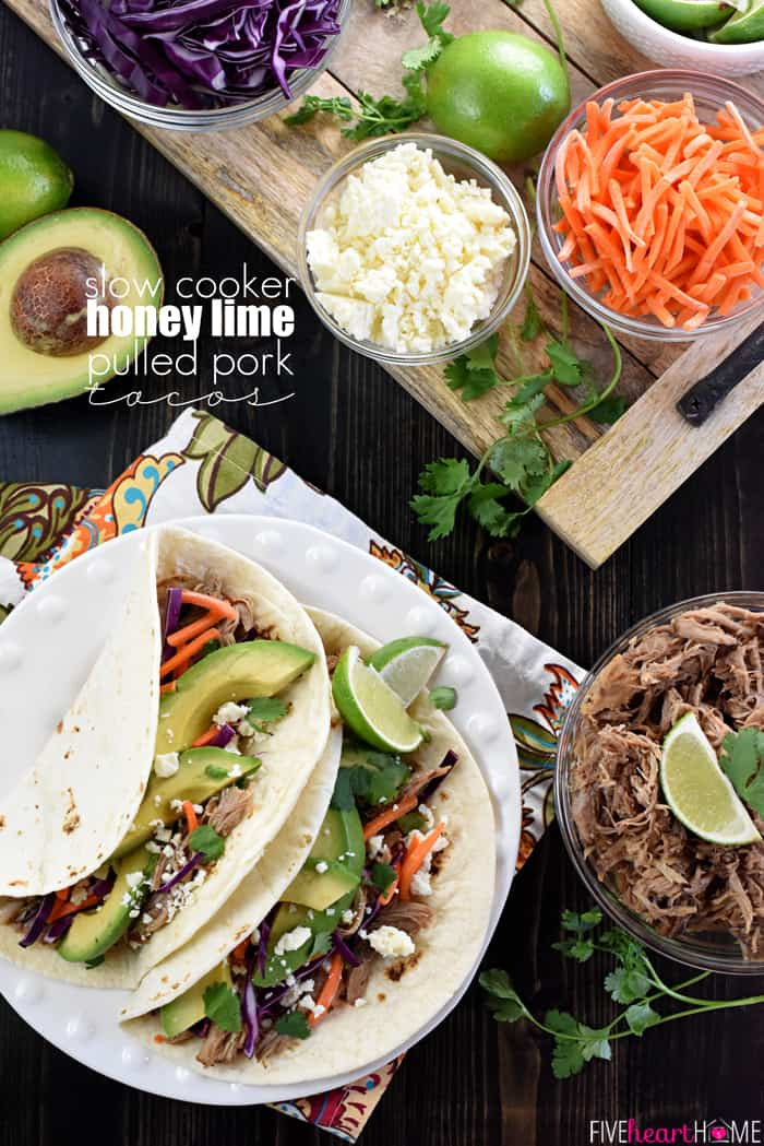 Slow Cooker Honey Lime Pulled Pork Tacos ~ tender, spicy-sweet pork piled on flour tortillas and topped with red cabbage, carrots, avocado, cotija cheese, and fresh cilantro for an easy, effortless dinner...and the leftover pork is fantastic on nachos! | FiveHeartHome.com