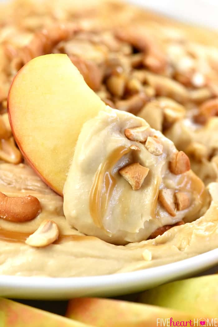 Caramel Apple Cheesecake Dip Scooped Up on an Apple Wedge