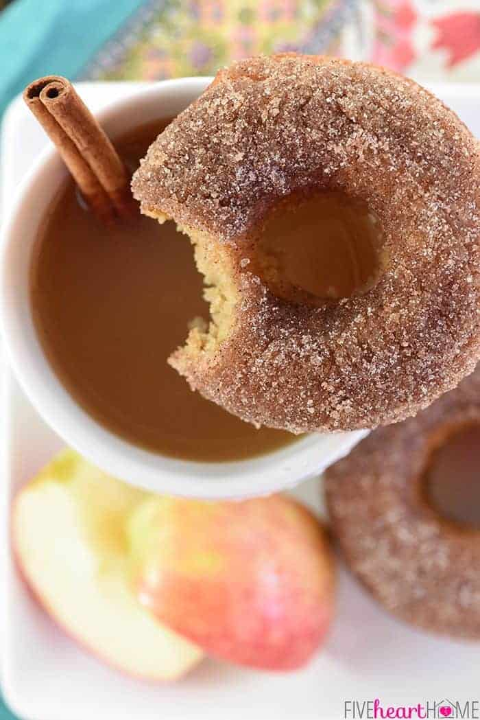Apple Cider Baked Donuts ~ these delicately spiced, 100% whole wheat donuts are tender on the inside and coated in crunchy cinnamon sugar on the outside for a tasty fall breakfast treat!   FiveHeartHome.com