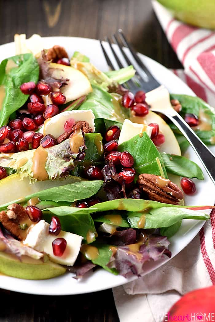 Thanksgiving Salad ~ this gorgeous Pomegranate, Pear, Pecan, & Brie Salad with Homemade Balsamic Vinaigrette Served in a White Bowl