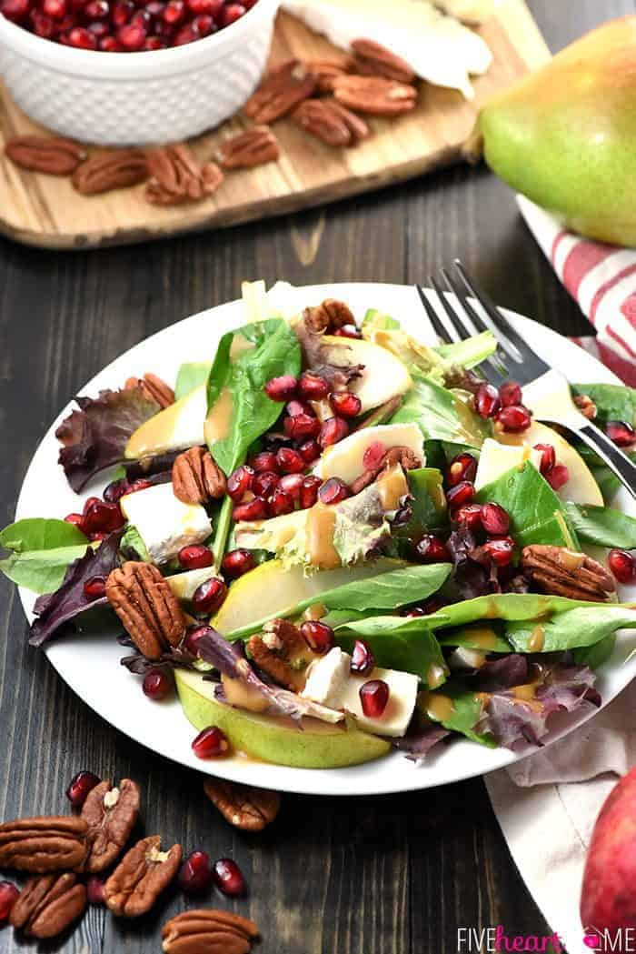 Thanksgiving Salad ~ this gorgeous Pomegranate, Pear, Pecan, & Brie Salad with Homemade Balsamic Vinaigrette is loaded with vibrant colors and flavors and contrasting textures. It would be the perfect addition to your Thanksgiving or Christmas holiday table, or it would make any dinner special! | FiveHeartHome.com