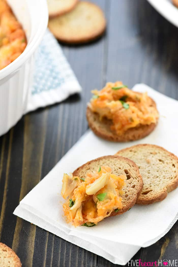 Cheesy Crab Dip ~ loaded with sharp cheddar, lump crab meat, and a zippy kick of Sriracha, this delectable appetizer recipe is perfect for any gathering, from a casual football-watching get-together to a fancy holiday party! | FiveHeartHome.com