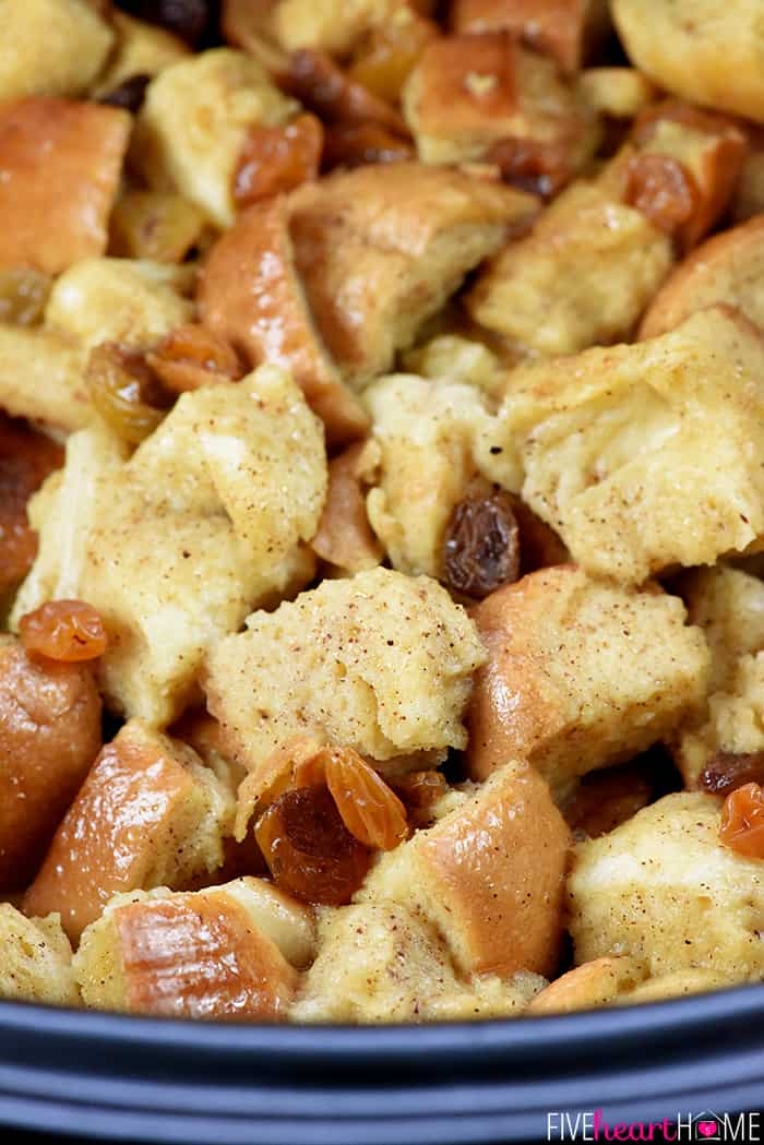 Slow Cooker Eggnog Bread Pudding ~ this decadent holiday breakfast, brunch, or dessert is studded with golden raisins, sprinkled with nutmeg, and drizzled with a silky eggnog syrup...and it effortlessly cooks up in the crock pot, freeing up the oven for other recipes! | FiveHeartHome.com