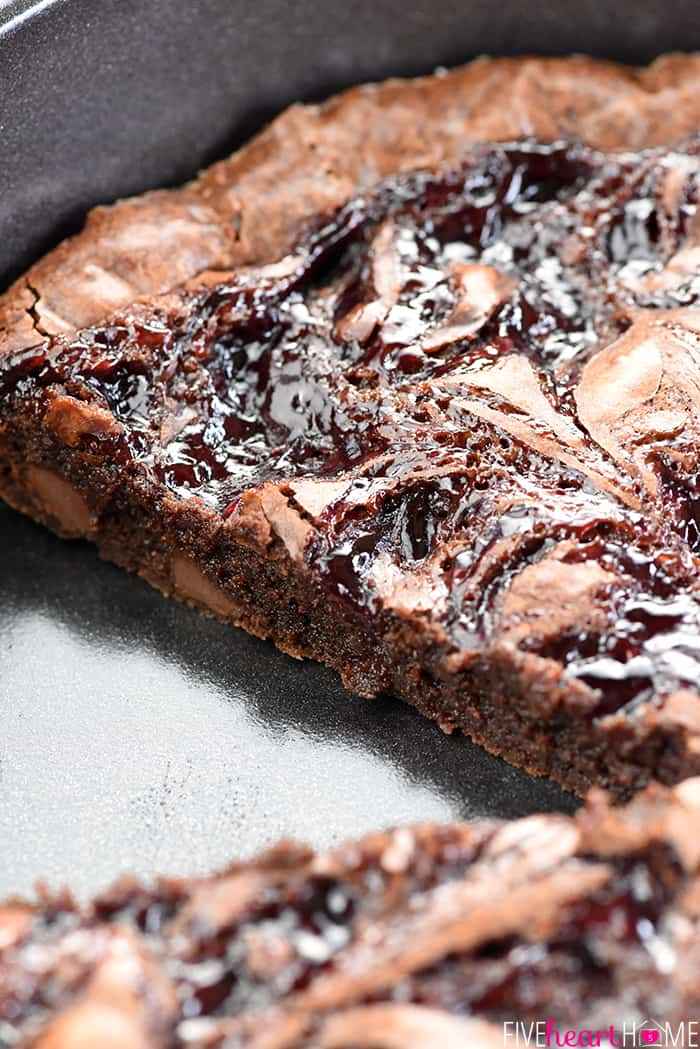 Raspberry Swirl Brownies ~ fudgy brownies are studded with chocolate chips, topped with raspberry preserves, and sliced into wedges in this rich, decadent dessert, perfect for Valentine's Day or as an anytime sweet treat! | FiveHeartHome.com
