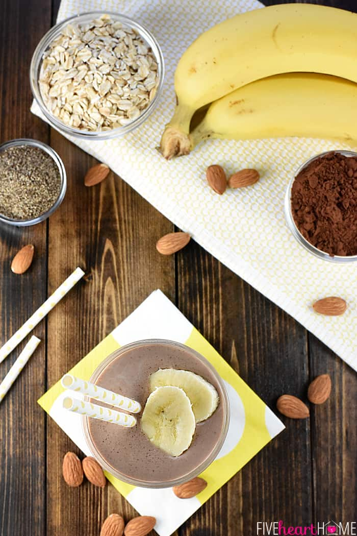 Smoothie ingredients including bananas, oats, cocoa powder, chia seeds, and almond milk
