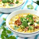 Slow Cooker Mexican Street Corn Chowder ~ the savory flavors of Mexican street corn come together in an easy crock pot soup that's slightly spicy, slightly smoky, and topped with avocado, bacon, cilantro, and cotija cheese! | FiveHeartHome.com