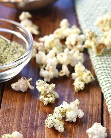 Parmesan Ranch Popcorn scattered on tablel.