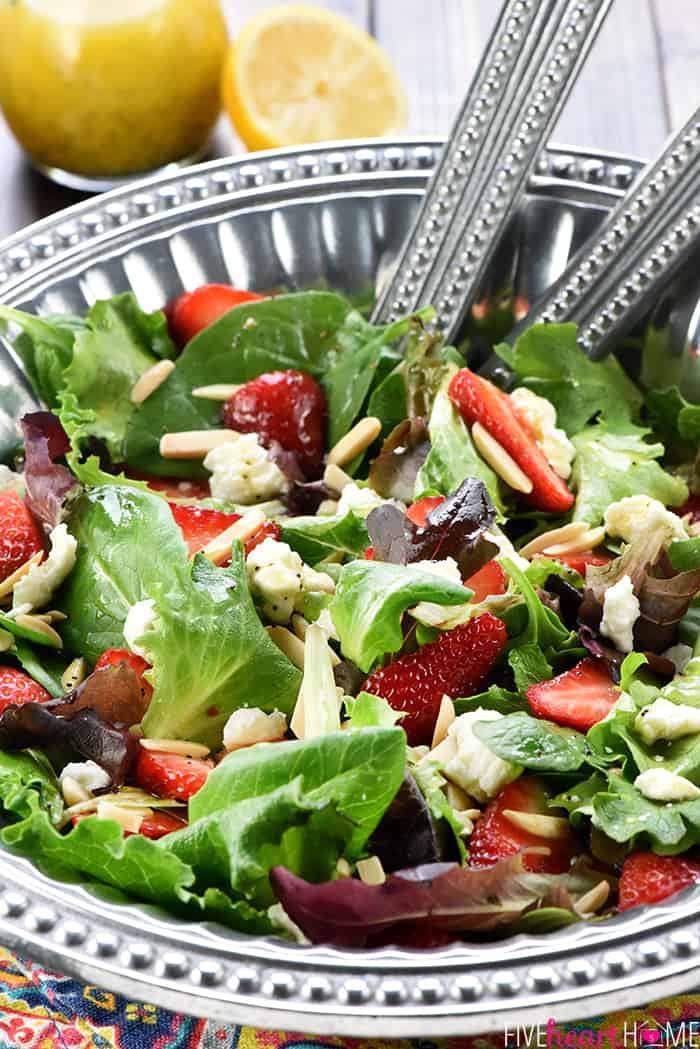 Easter Salad ~ this gorgeous Strawberry Goat Cheese Spring Greens Salad with Toasted Almonds & Lemon Honey Vinaigrette is loaded with vibrant colors and flavors and contrasting textures. It would be the perfect addition to your Easter holiday table, or it would make any dinner special! | FiveHeartHome.com
