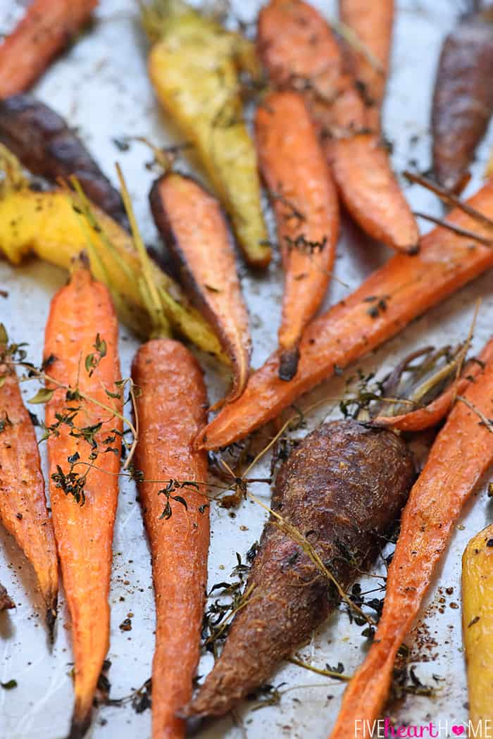 Roasted Rainbow Carrots with Thyme ~ tender and flavorful carrots make a rustic yet vibrant spring or Easter side dish that's as gorgeous as it is delicious! | FiveHeartHome.com