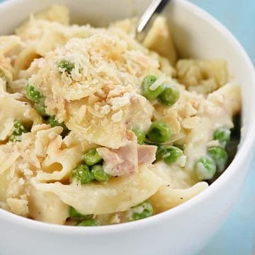 Stovetop Tuna Noodle Casserole Skillet ~ a quick and easy, comforting dinner recipe loaded with tuna, egg noodles, peas, and a creamy, cheesy, from-scratch white sauce! | FiveHeartHome.com