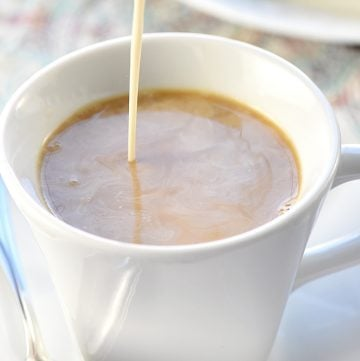 Caramel Brulée Coffee Creamer being poured into cup of coffee.