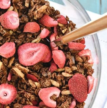 Nutella Strawberry Granola ~ this homemade granola recipe features wholesome oats, coated in chocolate hazelnut spread and studded with crunchy almonds and freeze-dried strawberries for a yummy snack or breakfast treat! | FiveHeartHome.com