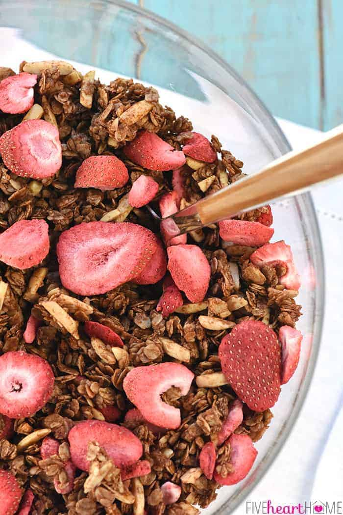 Aerial view of a bowl of Strawberry Granola with a spoon