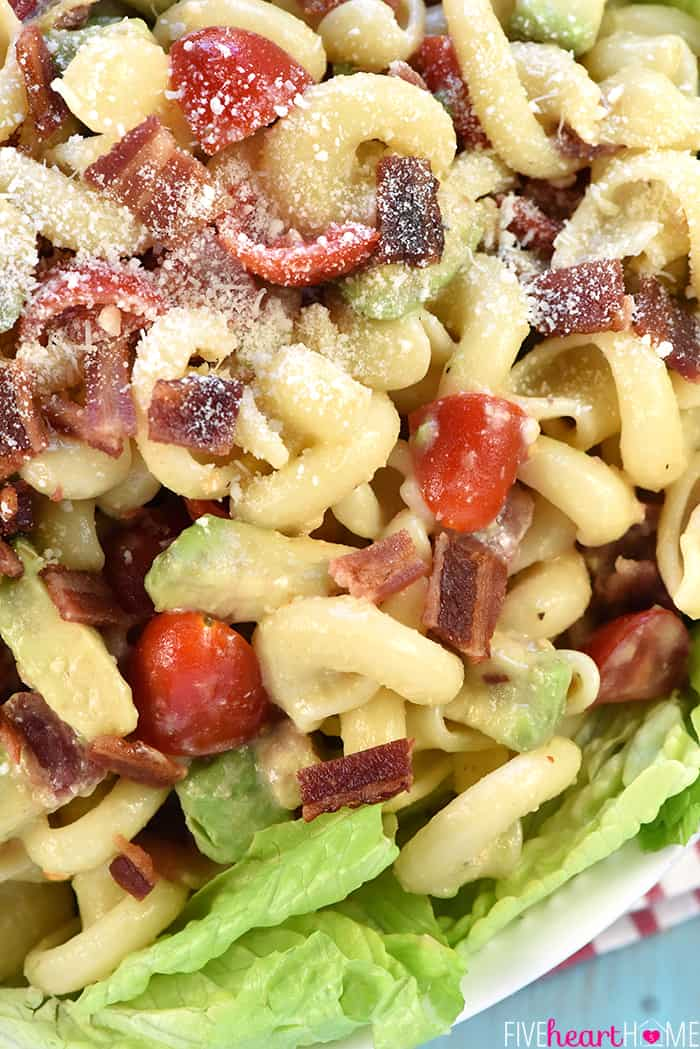 BLT Caesar Pasta Salad with Avocado ~ loaded with crispy bacon, juicy tomatoes, creamy avocado, and tender pasta dressed in tangy Caesar dressing and served atop a bed of fresh lettuce! | FiveHeartHome.com