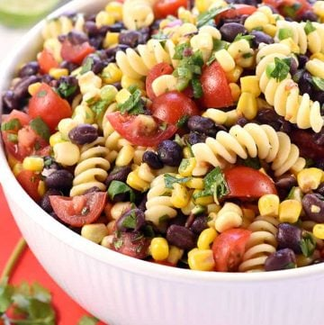 Fiesta Pasta Salad ~ loaded with corn, black beans, tomatoes, jalapeño, cilantro, and a fresh lime vinaigrette for a zesty, flavorful, summer side dish! | FiveHeartHome.com